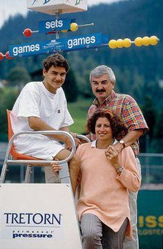 young Roger Federer with his parents