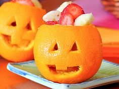 For these jack-o-lantern fruit bowls, start by spooning out the orange flesh and carving whatever Halloween-friendly face you desire into the peel, then fill with fruit. Or, if you'd rather serve yogurt or oatmeal, color faces with Sharpie instead.