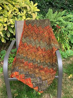 This cozy throw was designed for my sweet son, Nicholas, and his darling wife, Sasha. I used one of my favorite knitting techniques, Entrelac, a knitted fabric that looks woven. Make one for yourself or a loved one, and cuddle up!