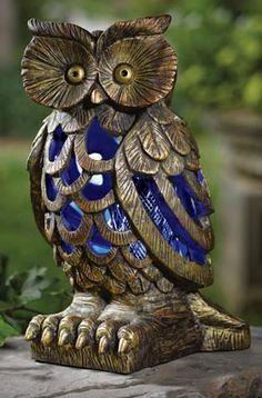A solar powered owl bug zapper