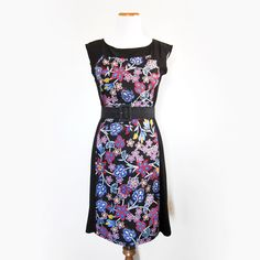 This women's dress was designed by Tammy Beauvais (Mohawk Nation) and features a Native American floral design throughout the front. The dress ...