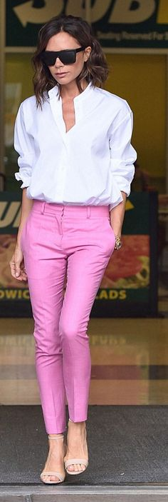 Who made Victoria Beckham's gold watch, nude sandals, white button down shirt, pink pants, and black sunglasses?