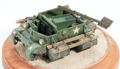 To transfer supplies across the Irrawaddy River in Burma in 1944, the British 14th Army floated a Universal Carrier with barrels and large wooden paddle. Gary attached barrels to a Tamiya 1/48 scale carrier he had detailed with Voyager photoetched metal and M.V. Products lenses