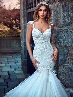 Ms. Elle - La Secret Royal Collection Galia Lahav Ms. Elle is inspired by the royal white peacock and has an accentuated trumpet style silhouette. The gown is made from a variety of embroidered appliques and combined together to create a new style for bridal. The embroidered features cascade down the back of the skirt forming two scalloped wings.