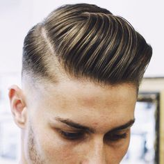 Slicked Hard Side Part + High Fade