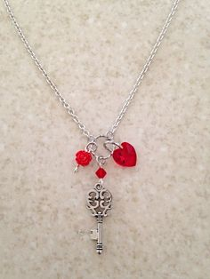 Hey, I found this really awesome Etsy listing at https://www.etsy.com/listing/244399374/key-neckace-with-red-swarovski-heart