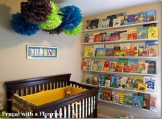 who needs wallpaper?? these floating bookshelves look terrific in a kid's room... although I wouldn't mind decorating my own walls with books, either.