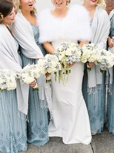 Bride and Bridesmaids cover up ideas | Wedding cover ups | Fur meets shawls = stunning.  This totally stunning cover ups are a perfect match for this winter wedding.