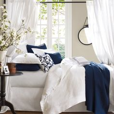 thinking of adding navy to our white and cream bedroom
