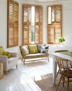 Love how these plantation shutters make the room pop.