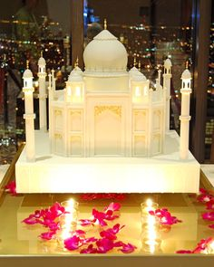 Taj Mahal, Literally - Okay, for years we've been making wedding cakes inspired by the Taj Mahal. Ones with the domed top, others with the archways and minarets. This time, we just gave in, and made the Taj Mahal out of cake. Complete with light up edible towers and a custom built (by our own Magic Phil) cake stand that held water to float orchids and candles, it really doesn't get more romantic than this.