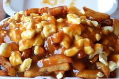 Poutine - French fries topped with a gravy sauce and cheese curds (Quebec/Canada)