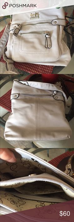 COACH Crossbody Vintage. No serial number. Have had it a long times. Can't guarantee authenticity. It was a gift. I know coach didn't always use serial numbers. Thus the price. 3 inside compartments. One outside zip in front and one inside zip. One slip inside. Not intentionally trying to sell replica. If it is it's a darn good one. I was told when given to me it was authentic.  11 x 20 x 3 Coach Bags Crossbody Bags