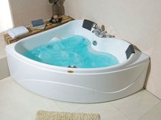 corner jetted tub 2 person. get rid of the old  gross hot tub and put in a two person jetted soaking Two Person Whirlpool Tub from Jacuzzi new Aquasoul Double