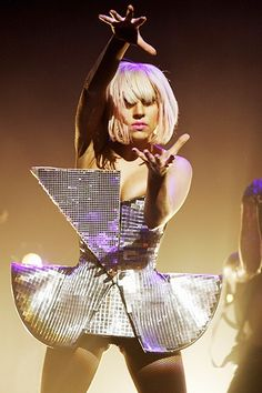 Inspired by her original sequined disco bra, Gaga covered her entire abstract costume in the sparkling disco material performing at Brixton ...