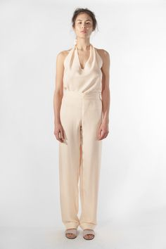 The EINE Halter-neck Top is the contemporary classic piece of the collection. This garment is ideal for solitude and social events, and can be worn inside or outside of the home.  #einestudios #eineltd #halternecktop #top #cream #womensfashion #loungewear #luxury #ladieswear #lounging #halterneck #highend #highendfashion