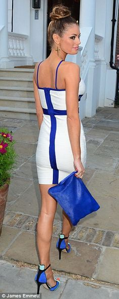 A bit of all white: TOWIE star Chloe Sims showed off her surgically-enhanced figure in a white bandage dress