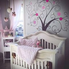 The tree wall mural with pink flowers was painted for my baby girl's nursery by a wonderful friend: The ideas that I used for Avery's dream nursery decorated in pink and brown came from baby girl nursery pictures that I found online and in home decorating