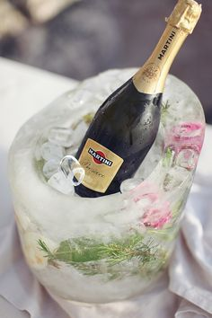 floral ice bucket to chill your champagne. i'd like a DIY on how to make this. i know it's not rocket science but who knows. #drinks http://www.weddingchicks.com/2013/11/14/sveti-stefan-island/
