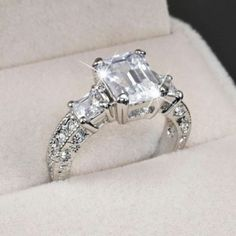 Emerald Cut Diamond Engagement Ring....this is similar to mine.  Much prettier than a round or princess setting.
