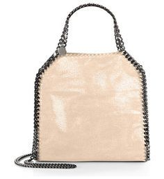 Mini baby bella shoulder bag by Stella McCartney. A smaller version of the classic Falabella, all crafted from shimmering faux suede and finished w...