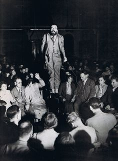 "Spiritualist Colin Evans ""levitating"" at a spiritualist meeting in London."