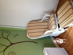 Baby's room w freshly painted glider and recovered cushions
