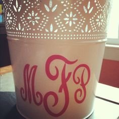 put a monogrammed car decal on a trash can to make it cute! :) going in my dorm