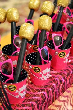 "Kit Kat piano, silver favor stands using chargers, ""rock"" candy, pretzel drum sticks, etc."