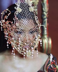 """Nicki in Rinaldy A. Yunardi caged mask for """"No Frauds"""""""