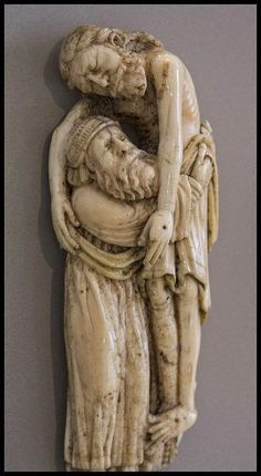 Joseph of Arimathea takes Jesus from the Cross- medieval ivory in the Victoria & Albert Museum