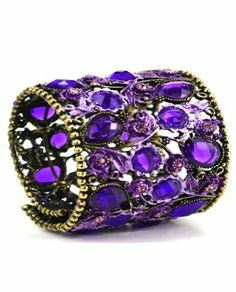Handmade Brass Purple-Colored Crystal Cuff Bracelet, 'Eternal Elegancy' Nina of Egypt. $28.99. Adjustable size cuff bracelet.. Hand-engraved with floral patterns.. All handmade and hand-engraved by the most talented artisans.. Each inlaid with a different vivid colored crystals.. Egyptian handmade rusty gold tone filigree cuff bracelet.. Save 26% Off!