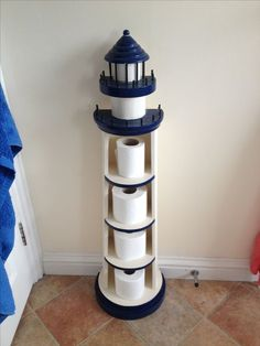 Lighthouse toilet paper roll holder. What a fun idea. Tried to find source -no success. Completely Coastal: http://www.pinterest.com/complcoastal/nautical-decor/