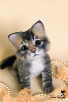 """Kitten: """"Pearls with kittens ~ and warm woolen mittens ~ these are a few of my favorite things..."""":"""