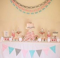 Rebekah's first birthday party was themed around baby elephants which was nicely complimented by the pink, grey and aqua colour accents used in the decor and party food.For a full list of suppliers vist Tanya's blog.