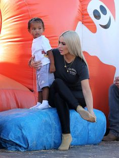 Ready to go: The Vogue star was seen riding down a slide with both North and Saint. Good thing the daughter of momager Kris Jenner, took off her four inch heels for the experience Kardashian Jenner, Kylie Jenner, Kardashian Family, Kourtney Kardashian, Jenner Kids, Pointy Boots, Beautiful Pregnancy, Kool Kids, Concert Shirts