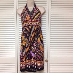 "Amazing halter dress Amazing dress with halter design. V neck design. New with tags.  Pullover type. 96% polyester 4% spandex 16 1/2"" bust laying flat, 16 1/2"" waist laying flat, 28 12"" length. Great for summer! No trades. AGB Dresses"