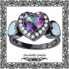 From Victorian sweetness to romantic horror, medieval gemstone diamond engagement rings are highly symbolic selections for several couples who embrace a medieval lifestyle. Gothic Wedding Rings, Skull Wedding Ring, Victorian Engagement Rings, Opal Wedding Rings, Gothic Rings, Designer Engagement Rings, Opal Rings, Black Opal Ring, Mystic Topaz