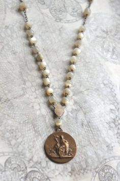 Lady and the Lion-Mother of pearl necklace vintage lion medal