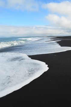 Black sand, white foam.