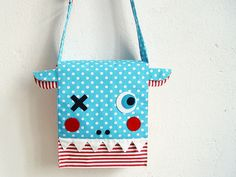 Monster messenger bag by revoluzzza - so cute I could weep.  And pee.