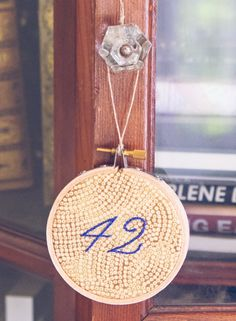 42 hand-embroidered hoop wall hanging / wall art
