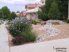 Small Front Yard Desert Scene - Sometimes the easiest thing is to duplicate or copy what you see in nature. This desert scene fake river bed idea is common in so many desert landscapes and xeriscapes.