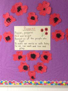 Poppy Poem surrounded by a heart of poppies (each one made with 4 hearts). Poppy Poem surrounded by