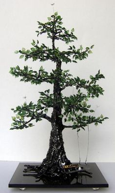 If only I could weld....welded stainless steel tree with glass leaves