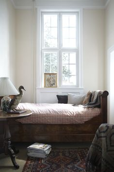 boys room!  antique wood bed and gingham bedding, antique rug, and vintage wool blankets.