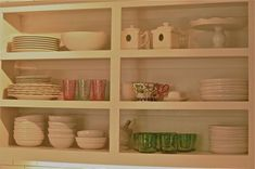 Open kitchen shelving and cabinets. Great redesign for old cabinets, just throw away the old doors and paint the shelves.