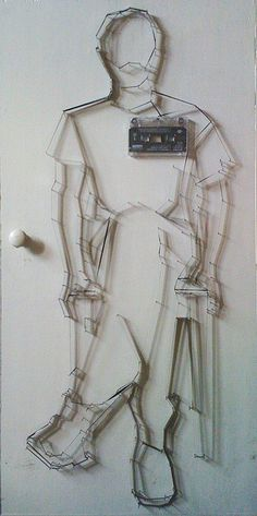 Audio cassette tape nailed to door. by mike fell