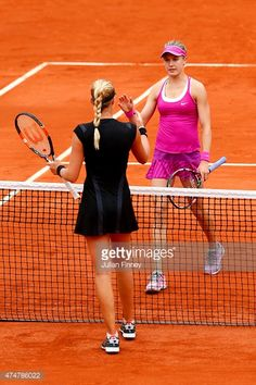 Eugenie Bouchard of Canada shakes hands at the net with Kristina Mladenovic of France following her defeat in their women's singles match on day three of the 2015 French Open at Roland Garros on May 26, 2015 in Paris, France.
