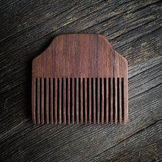 A classic in design. Subtle, and understated. The Reclaimed Black Walnut is a solid comb known for its timeless look. 20 teeth are hand cut, sanded and filed to give you an even, tangle free stroke. Sourced from North Western Canada, the Black Walnut is a comb that won't be soon forgotten.